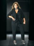 Uniquely designed pant that alludes to a slender thigh and a slimming waist due to overlapping collared waist on a button and belt along with shiny ankle cuffs. Material: polyester