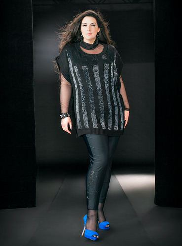 Shiny black leggings with a sparkle design on the side calf has an